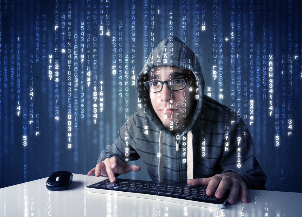 Hacker decoding information from futuristic network technology with white symbols